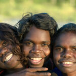 Three smiling Aboriginal children